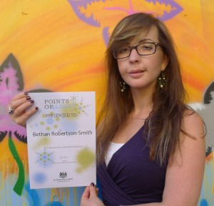 Bethan with her Points of Light award from David Cameron